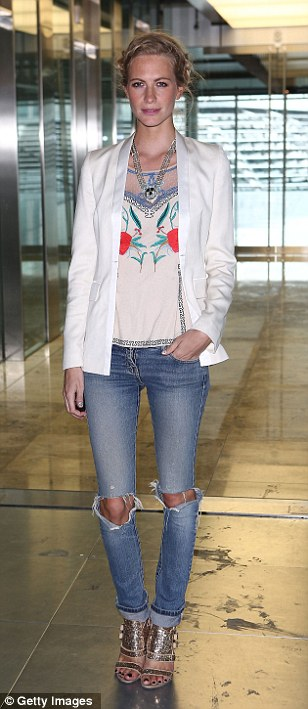 Poppy Delevingne arrives to support sister Cara at today's show