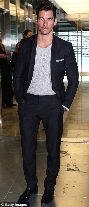Supporting role: David Gandy arrives to watch his girlfriend Sarah Ann Macklin walk in the Williamson show