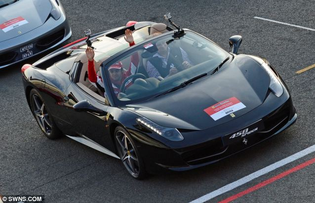 F1 ace Felipe Massa led the pack from behind the wheel of a black Ferrari 458 Spider