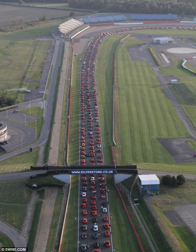 World record: An aerial shot of Silverstone as 964 Ferraris worth more than £100m took part in a parade of the iconic Italian carmaker