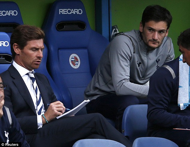 Off the mark: Villas-Boas (left) is watched closely by reserve goalkeeper Hugo Lloris