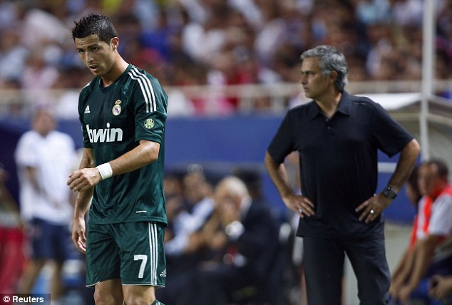Brooding? Cristiano Ronaldo (left) and his Real Madrid team have been beaten in two of four La Liga matches