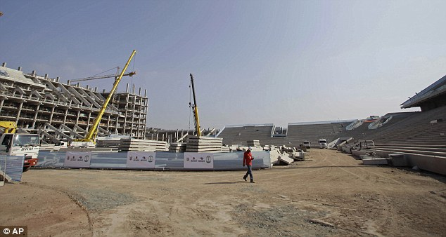Long trek: The World Cup in Brazil will not be fan-friendly... even if the stadiums are completed in time