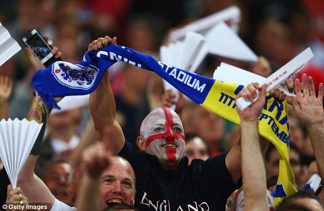 Loyal fans: England supporters watch their side draw with Ukraine at Wembley last week