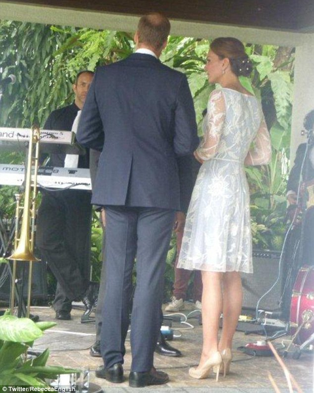The pair take in the entertainment during a tea party at the British High Commission in Kuala Lumpur