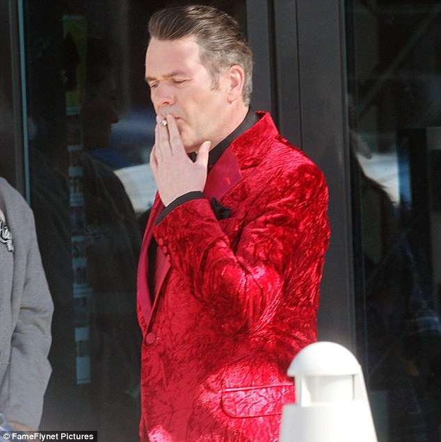 Sneaky: Chris Moyles was seen enjoying a cigarette in full costume as King Herod in Jesus Christ Superstar