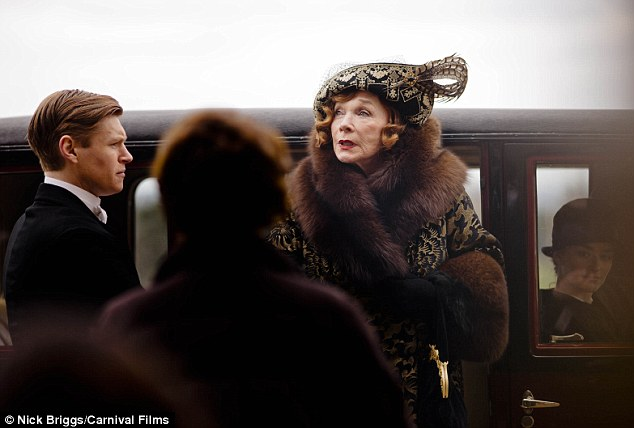 Inspecting her surroundings: Martha looks around as the the much-loved Downton characters return