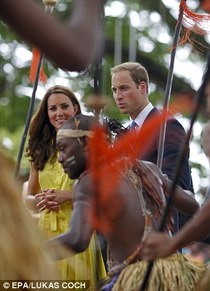 Earlier on the visit the royal couple were greeted and cheered by thousands of barefoot well-wishers in the Solomon Islands today