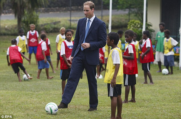 Having a ball: The Duke of Cambridge even found time to briefly demonstrate his football skills with local boys in Honiara as part of the day's itinerary