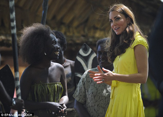 All smiles: Traditionally-dressed local villagers were in a friendly mood during the day as they happily chatted to the Duchess of Cambridge