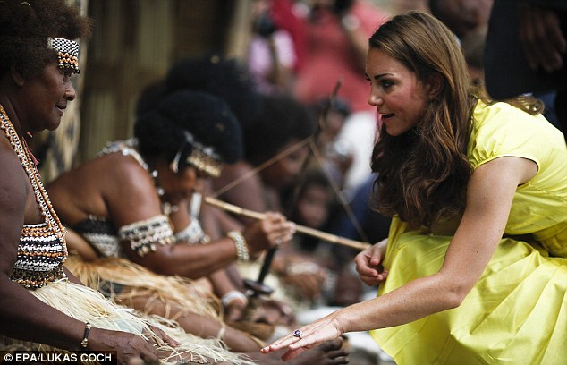 Local culture: The Duchess talks to a woman in traditional costume while stopping to get to know villagers who came out to greet her and The Duke