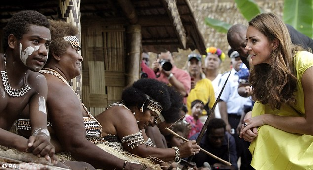 Joking: The Duchess shares a joke with one of the women making crafts in the cultural village
