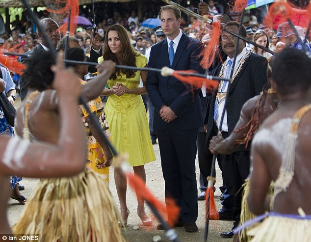 Concentrating: The Duke and Duchess of Cambridge watch as the group of tribal dancers brandish rather fearsome spears