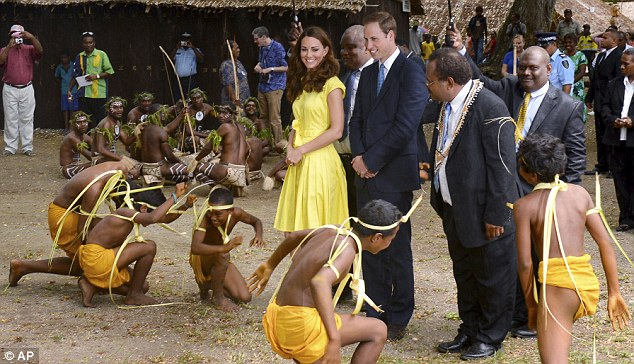Matching outfits: Kate beams as a group of young dancers perform for her and William - did they know she was going to wear yellow?