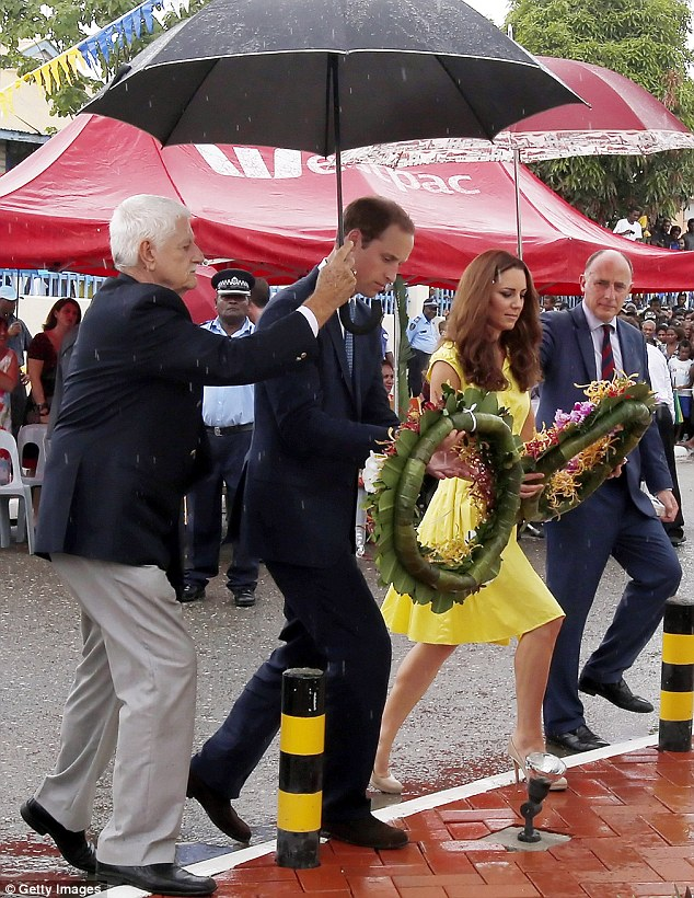 Paying respects: The Duke and Duchess battle through a downpour to each lay a wreath during their visit to the Coast Watcher and Solomon Scouts Memorial