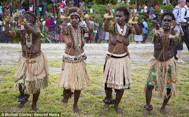 Hello! The Duke and Duchess of Cambridge receive a traditional welcome from locals when they land in Marau