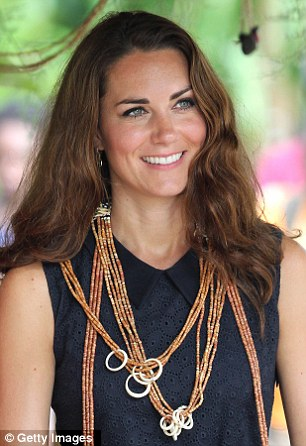 Offset: The beaded necklace given to the Duchess goes perfectly with her navy Mulberry dress