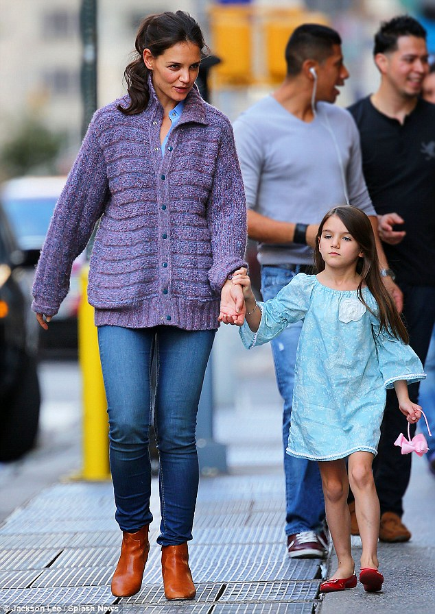 Quality time: Katie Holmes and her daughter Suri were spotted going for an early evening stroll in Manhattan today, following the six-year-old's first week at primary school