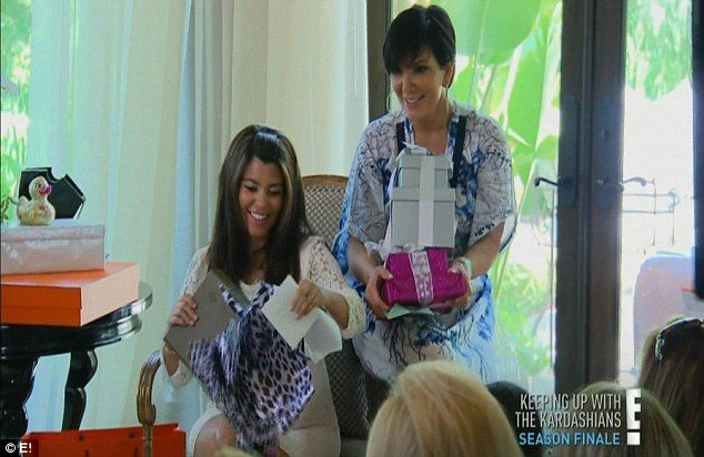 Gift giving: Kourtney opened a menagerie of baby goodies at the shower, watched by mother Kris