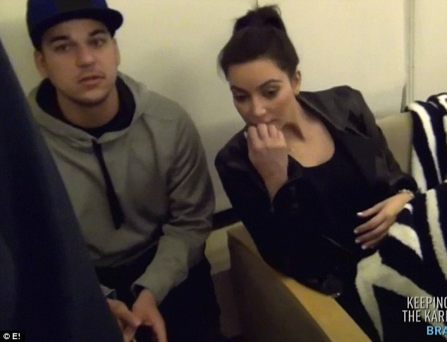 Nail-biting: Kim appeared to be chewing her nails during the process