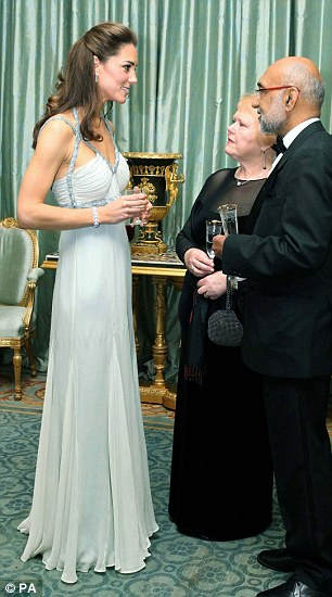 The Duchess of Cambridge wearing Amanda Wakeley creations at a Clarence House private dinner, left, and on a visit to the Imperial War Museum, right