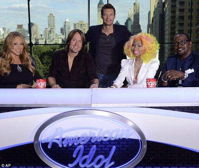 Happier times: Nicki and Mariah make up the Idol panel alongside Urban and Randy, with Ryan hosting