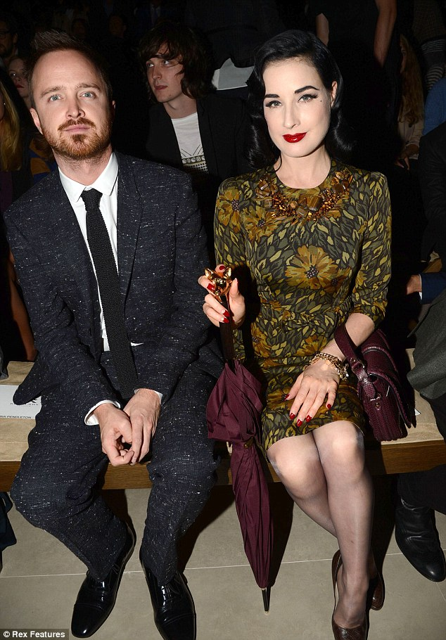 Up, close and personal: Aaron Paul and Dita Von Teese were both sat firmly on the front row