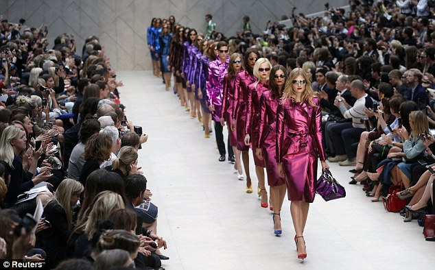 Awesome colours: The model present creations from the Burberry Spring/Summer 2013 collection