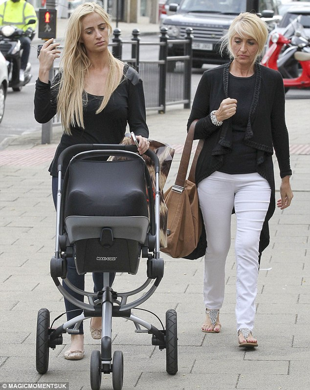 Supportive family: Chantelle was given a hand by her mother as the group headed out in Essex