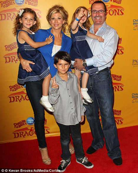 Focused on the family; Alexis with Jim Bellino with their children at the Los Angeles premiere of Ringling Bros