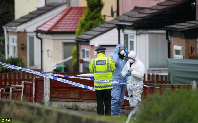 'Slaughter of the innocents': Forensic officers searched the scene of the shooting in Hattersley, Greater Manchester, after the attack yesterday