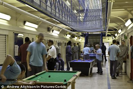 Prisoners on a recreation period at Aylesbury Young Offenders Institution: Mr Grayling says he would make sure jails are no longer places prisoners 'enjoy'