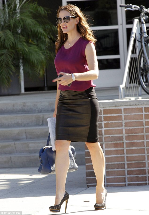 Leather lovely: Jennifer Garner was seen in a tight leather skirt and a burgundy blouse and killer heels yesterday