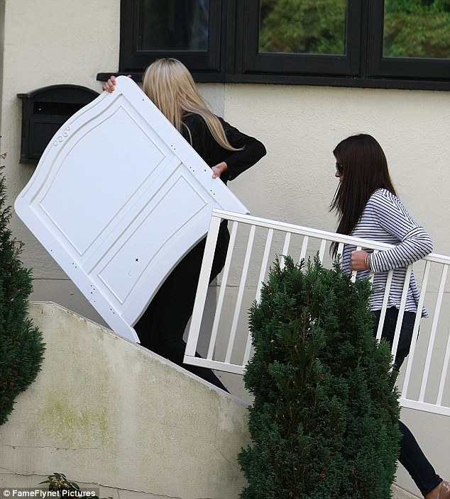 Focusing on her daughter: Chantelle Houghton is concentrating on looking after baby Dolly amid a very public war of words with Alex Reid. She was seen on Tuesday loading a new cot for her daughter into her house