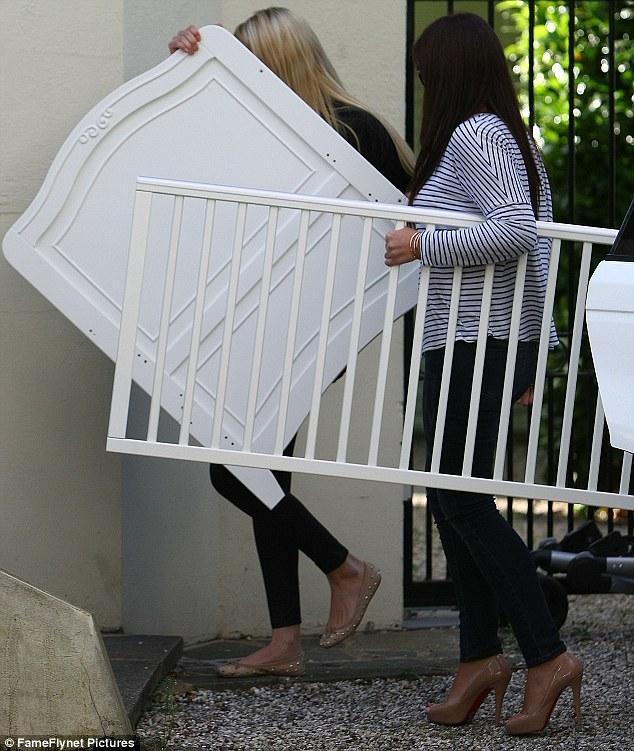 A friend in need: Chantelle calls in on a friend to help with moving her daughter Dolly's cot into the Essex home