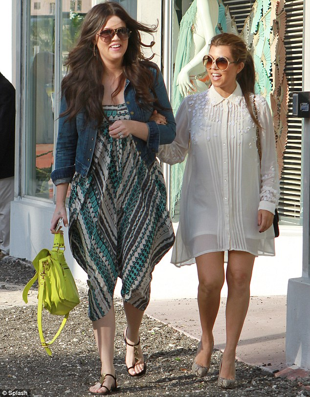Careful! Kourtney Kardashian dressed to impress for a shopping trip with sister Khloe in Miami on Tuesday, but perhaps didn't opt for the most sensible footwear for the outing