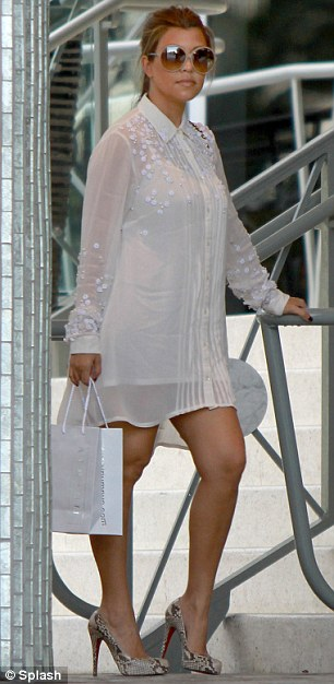 Sleek: Kourtney, who gave birth to daughter Penelope just two months ago, showed off her already-slim post-baby body in a white sequinned shirt dress
