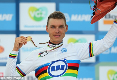 Champions again: Germany's Tony Martin celebrates with his gold medal after winning the Elite Men's Time Trial at the UCI Road World Championships
