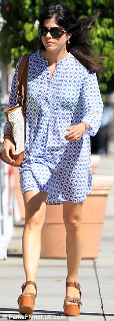 Dressing up: The Cruel Intentions star later slipped into a patterned smock dress and some platform wedges to head to a furniture store