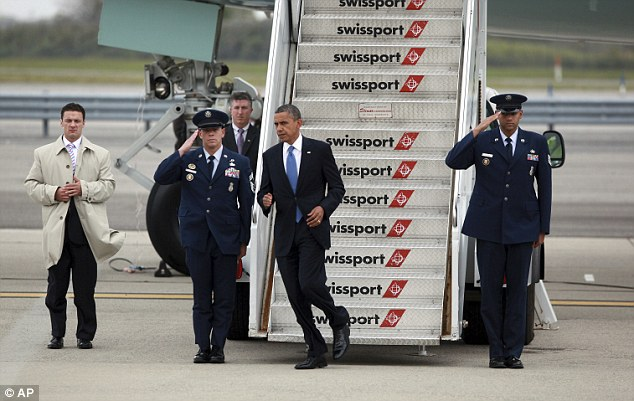 Running the campaign: Obama arrives at JFK on Tuesday for TV interviews and celebrity fundraising