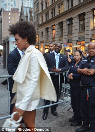 If your name's not down...NYPD counter-terrorism squad outside the Manhattan club where Obama drew an exclusive crowd including Beyoncé's sister Solange (right) seen entering