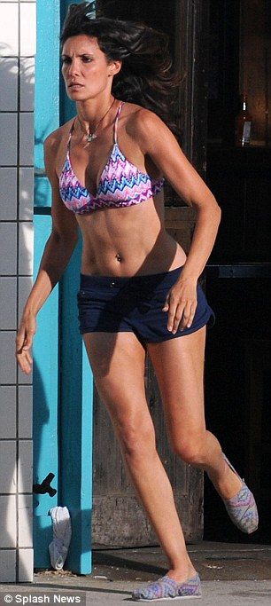 Crime fighter: The actress showed off her super fit figure