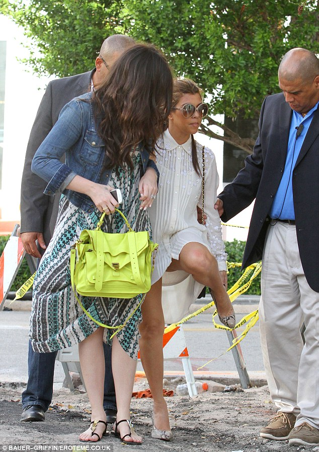 Mishap: Kourtney struggled to keep her shoes on her feet as she trod gingerly through the stony area