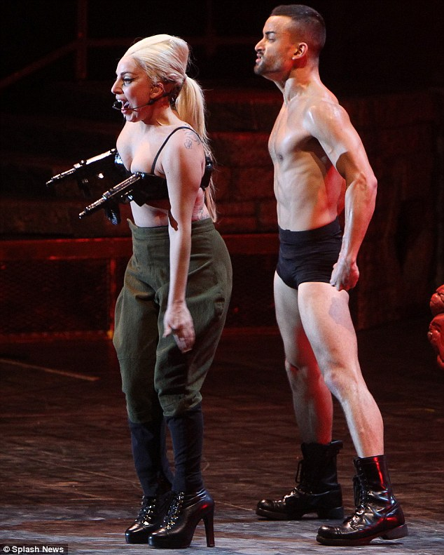 Fuller-figured: As Gaga later changed into a pair of high-waisted khaki trousers, her new curves were clear to see