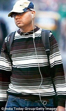 Banned: Young people spotted listening to music via their mobiles will be fined and hit with a shoe five times