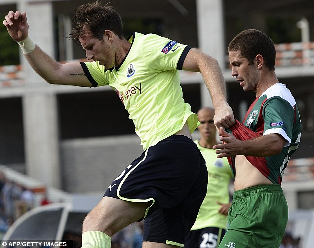 Get off! Mike Williamson wrestles for the ball against Maritimo