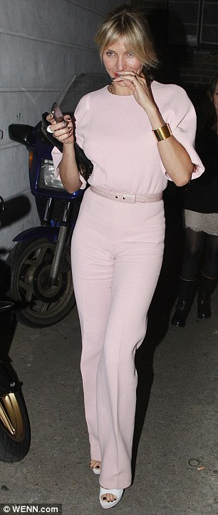 Stylish pair: Cameron looked pretty in a powder pink outfit, while Gwyneth wowed in her white dress