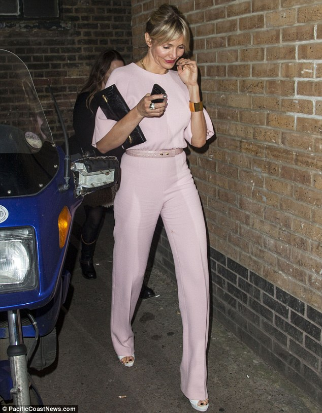 Chic: Cameron teamed her outfit with a gold bangle, black clutch bag and white peeptoe shoes for the event