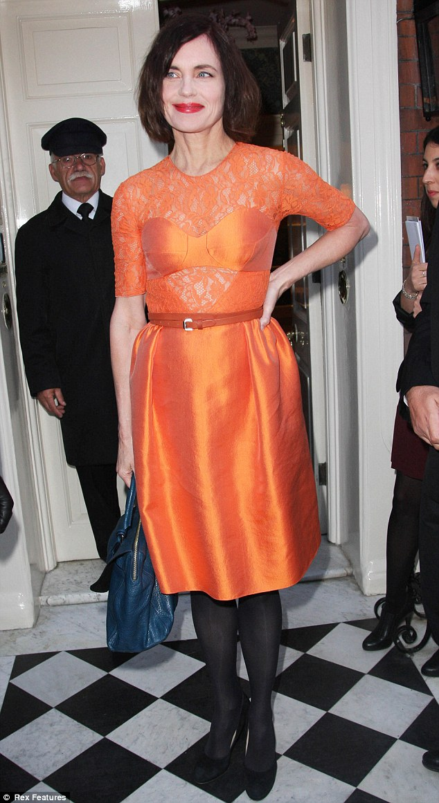 She'd elect Obama! Downton's Elizabeth McGovern shines in orange at the bash at St Mark's club
