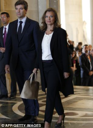 Ms Trierweiler (seen her with Minister for Industrial Recovery Arnaud Montebourg at the Department of Islamic Arts) has been a controversial figure since Mr Hollande was elected president